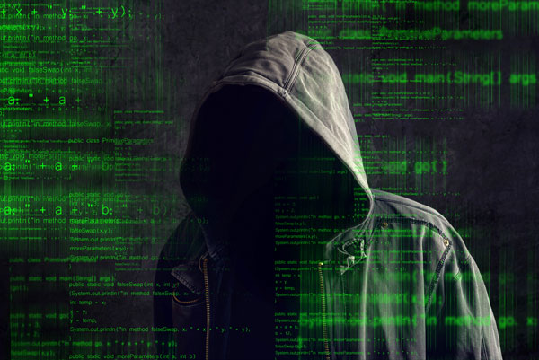 man in a dark hood with computerized background